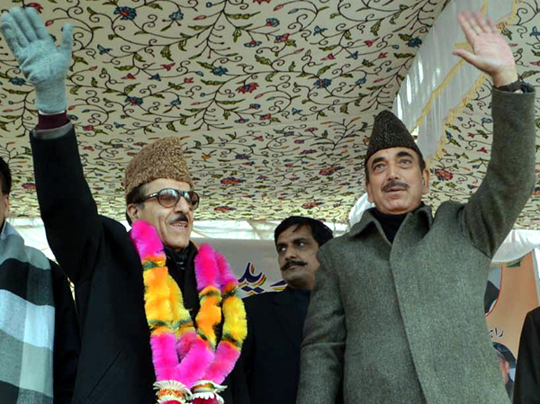 Union Minister for Health Ghulam Nabi Azad along with State Congress chief Prof Saif-ud-Din Soz wave to party workers during a rally at Shangus in Anantnag district on Saturday. -Excelsior/Sajad Dar
