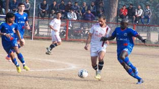 A tough tussle between the footballers of JK Bank and JK Forest teams in the semifinal matches at GGM Science College ground on Monday. -Excelsior/Rakesh