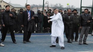 Chief Minister Omar Abdullah playing lawn tennis while inaugurating Olympic status swimming pool and allied infrastructure at Rajbagh in Srinagar on Saturday. —Excelsior/Amin War