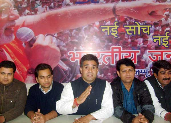 Ravinder Raina,Yuva Morcha State president alongwith other office bearers addressing media persons at party headquarters on Thursday.