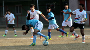 Footballer dribbling in style during a match of Christmas Soccer Championship in Jammu on Friday. —Excelsior/Rakesh