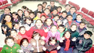 Participants of Winter Theatre Workshop posing for photograph at Jammu on Tuesday.