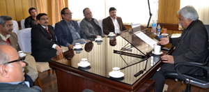 Minister for Labour, Ajay Kumar Sadhotra interacting with members of BBIA and CCI at Jammu on Tuesday.