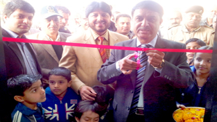 Mohd Latif Mir, Deputy General Manager, Circle Head J&K Operations along with other officials inaugurating ATM at Bari Brahmana on Tuesday.