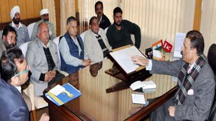 Transporters holding meeting with Transport Minister Ch Ramzan in Jammu on Tuesday.