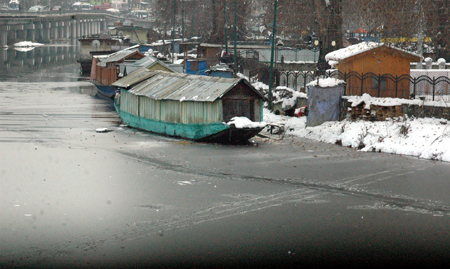 A view of world famous Dal Lake in Srinagar on Sunday where portion of the lake froze as chilly conditions further intensified. (UNI)