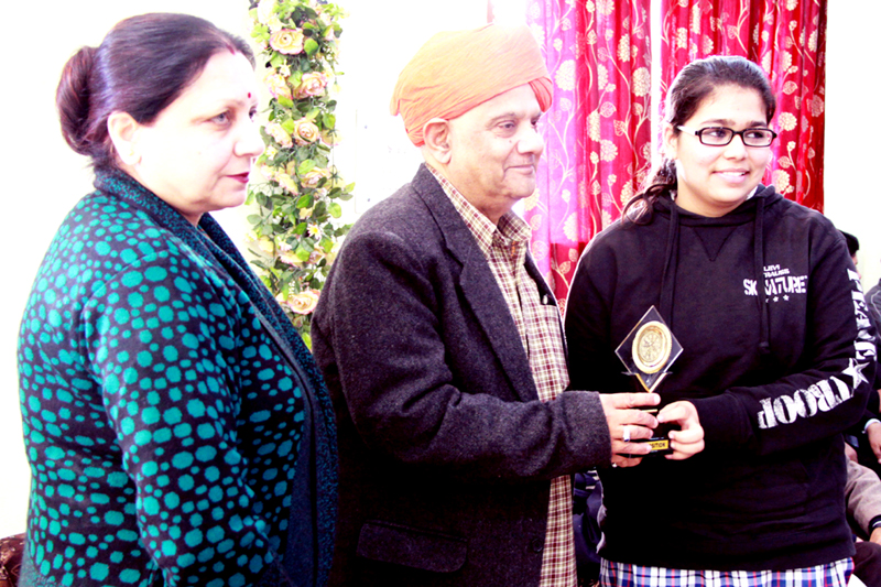 MLA Ashok Khajuria felicitating Annie Vaid during Symposium.