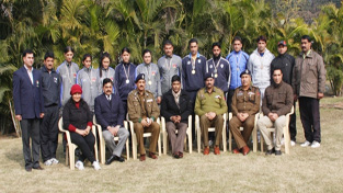 ADGP Armed, SM Sahai and other dignitaries posing alongwith sports personnel of J&K Police during felicitation function in Jammu on Thursday.