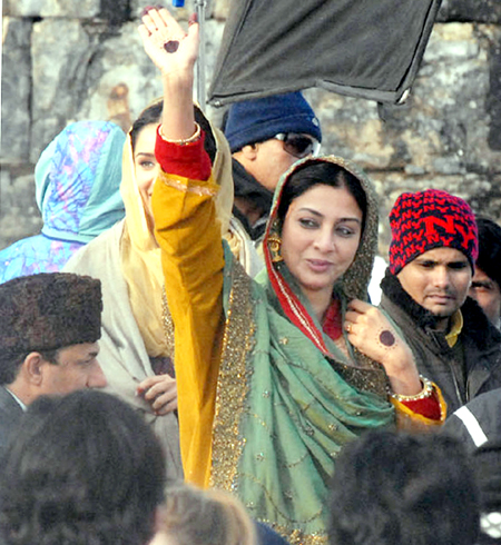 Bollywood actor Tabbu waves towards people during shooting for upcoming film 'Haider', at Martand Sun Temple in Anantnag district on Thursday. -Excelsior/Sajad Dar
