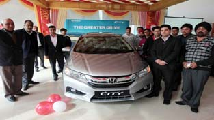 Officials of Hill View Honda, Sidhra during launch of All New 4th Generation Honda City on Tuesday. -Excelsior/Rakesh
