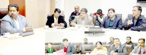 Minister for Housing and Culture Raman Bhalla chairing a meeting at Jammu on Friday.