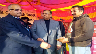 Chairman, JKGB, Vagish Chander giving away loan cheque to a beneficiary during a camp at Chowki Choura in Akhnoor.