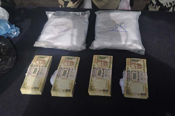 Fake currency and heroin seized by BSF at Pargwal on Friday.