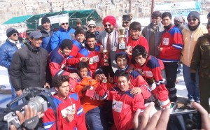 J&K Red team posing for a photograph alongwith the dignitaries after lifting the title trophy of National Jr Ice Hockey Championship.