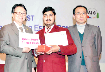 Dignitaries displaying Certificate of Honour and Special Prize received by MV International School, Jammu.