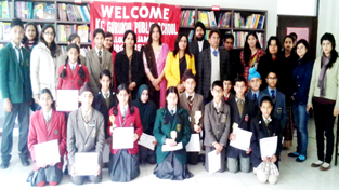 Prize winners of French Poetry Recitation Competition posing alongwith dignitaries at KC Gurukul School on Saturday.