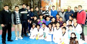 Players posing alongwith officials and dignitaries during concluding ceremony of 3rd Open J&K State Taekwondo Championship on Sunday.