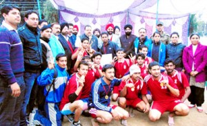 Jubilant Jammu district team posing for a group photograph alongwith chief guest, Devender Singh Rana in Jammu on Sunday.