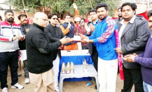 State BJP general secretary, Ashok Koul presenting winners' trophy to Chander Shekhar Azad Cricket Club on Sunday.