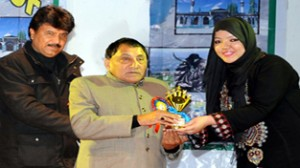 Advisor to CM, Qamar Ali Akhoon and MoS Information Technology Feroz Ahmad Khan distributing prize to a student at Jammu on Saturday.