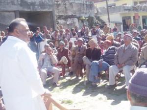 Rajneesh Sharma addressing Congress meeting at Bani on Wednesday.