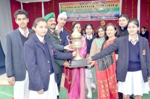 Students of Army Public School, Domana posing for a photograph during the prize distribution ceremony on Saturday.