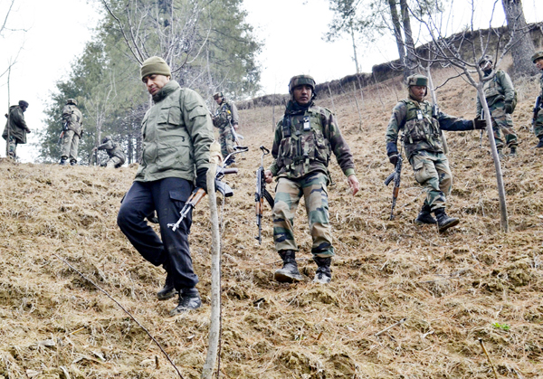 Troops during searches in Khoshipora forests of Baramulla district on Sunday. -Excelsior/Aabid Nabi