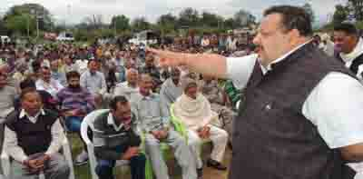 Provincial President NC Devender Singh Rana addressing a meeting at Bhalwal on Friday.