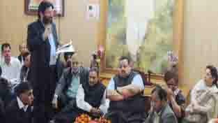 Provincial President NC Devender Singh Rana and other party workers during a meeting at Jammu on Tuesday.