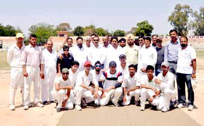 Jubilant KC Sports Club players posing for a photograph alongwith Minister for Sports, Raman Bhalla at MA Stadium on Tuesday.