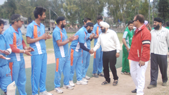 Chief guest interacting with the players of Glamorous Cricket Club in Poonch on Tuesday.