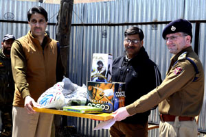 Sports gear being distributed by Police authorities in Sopore.