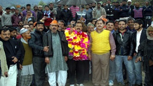 Dr Jitendra Singh being received by supporters on his arrival in Gool on Wednesday.