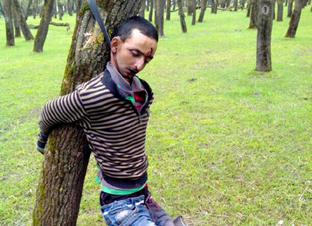 Dead body of youth, who was gunned down by armed men in Sopore on Sunday. -Excelsior/Aabid Nabi