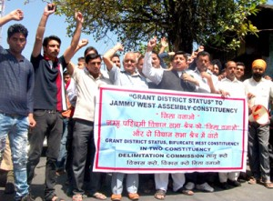 Sunil Dimple along with others during a protest in Jammu on Wednesday