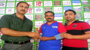 Man of the match award being presented during a match of Gufran Memorial T-20 Cricket Tournament in Doda.