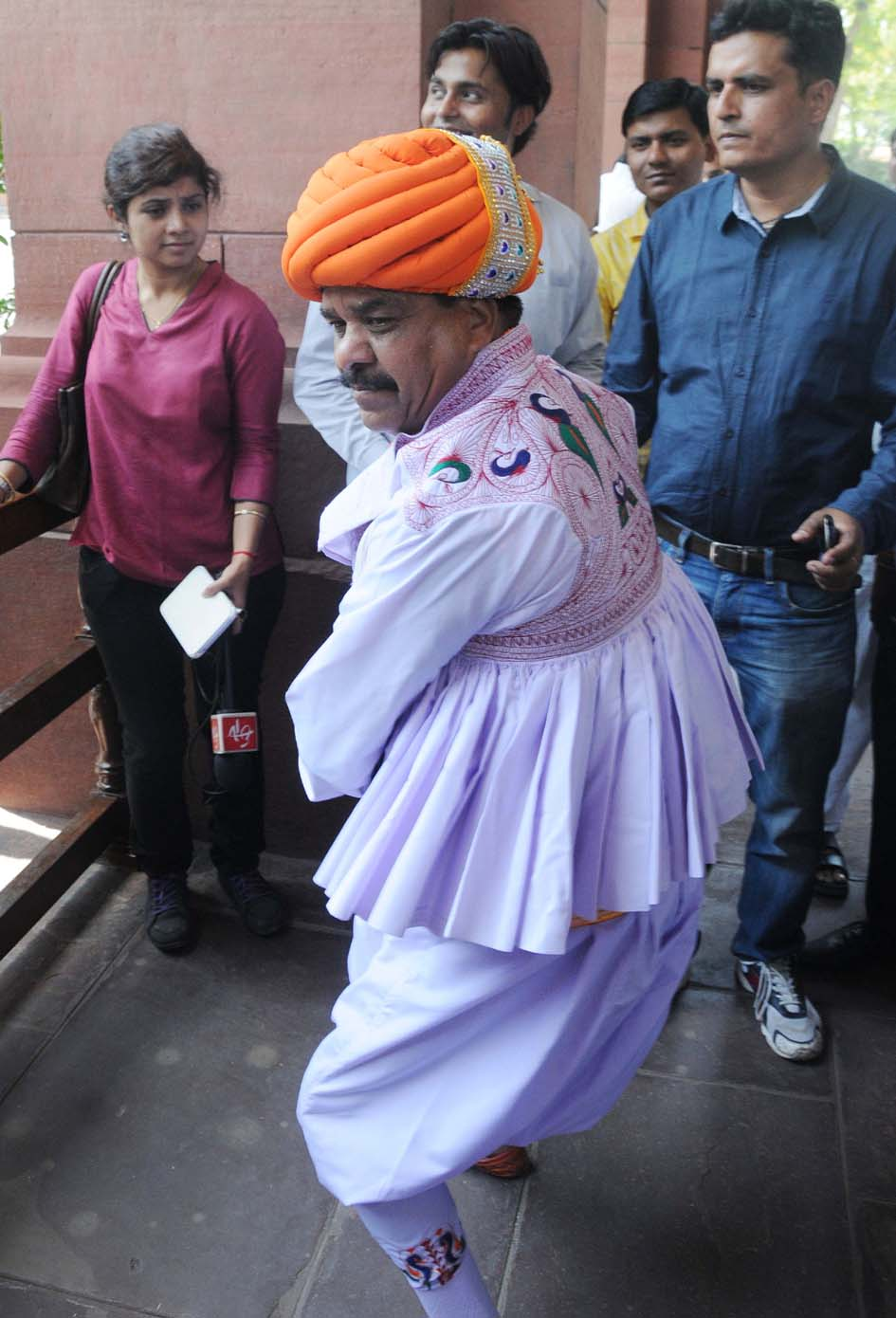 BJP MP Devji Bhai entertaining media personnel while entering Parliament House to take oath as Member of Parliament in New Delhi on Thursday. (UNI)