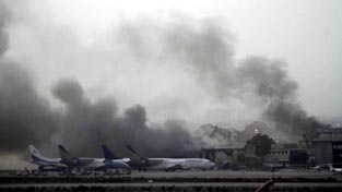 Smoke billows from Jinnah International Airport in Karachi.