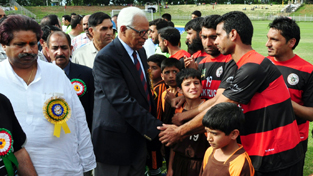 Governor N N Vohra interacting with footballers while inaugurating Invitation Football Cup in Srinagar.
