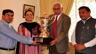 Governor presenting silver rolling trophy to Principal of GCW, M.A Road, Srinagar.
