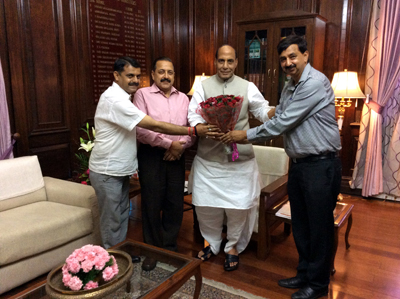 Union Minister Dr Jitendra Singh greeting Union Home Minister Raj Nath Singh during a meeting at New Delhi on Wednesday.