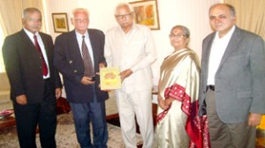 'The Languages of J&K' being presented to the Governor N N Vohra at Raj Bhavan on Monday.