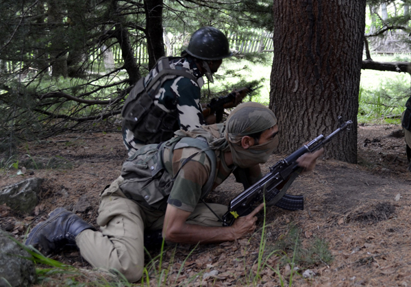 Security personnel in action during an encounter at Handwara on Wednesday. —Excelsior/Aabid Nabi