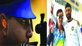 Gagan Narang (L) aiming at target while Jitu Rai (C) and Gurpal Singh (R) celebrate after their event at the Barry Buddon Shooting Centre.