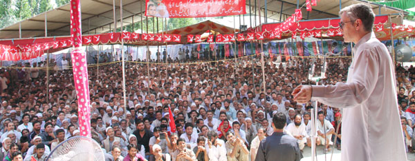 Chief Minister Omar Abdullah addressing NC workers' convention at Sumbal on Tuesday.