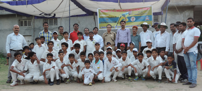 Budding cricketers posing for a group photograph during Under-14 boys cricket series in Jammu.