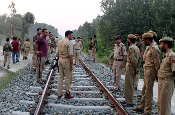 Security personnel inspecting the spot on a railway track at Malangpora, Awantipora in Pulwama after militants attack on a police constable. —Excelsior/ Younis Khaliq