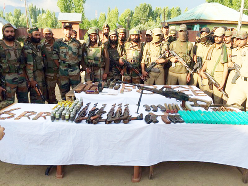 Arms and ammunition recovered by 6 RR and Handwara police from Hafrada forest.—Excelsior/Aabid Nabi