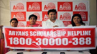 Executives of Aryans Group launching scholarship helpline number during a press conference at Jammu on Sunday.