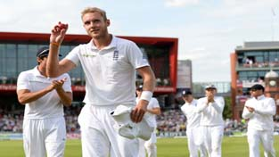 England's Stuart Broad holds the ball as he leaves the field after taking six wickets during the fourth Test match against India at the Old Trafford cricket ground in Manchester.